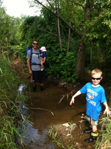 Exploring the creek that runs behind our house.