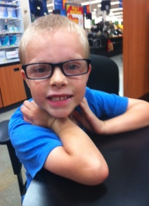 14.  My son getting his first pair of glasses.